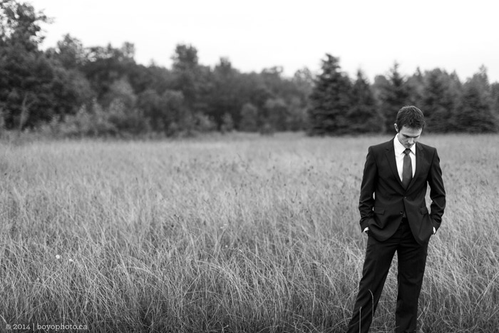 groom-waiting-for-bride-for-first-look-in-field-ottawa