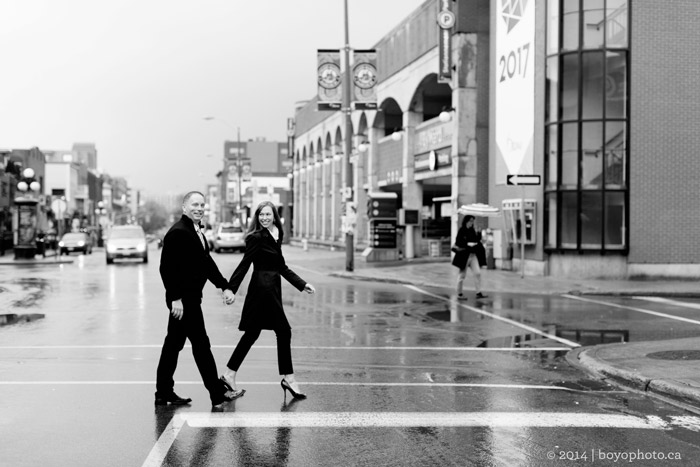 happy-couple-crossing-downtown-market-street-ottawa engagement photographer