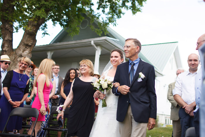 bride coming down the isle at the almonte herb garden wedding